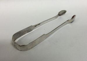 A pair of American Provincial silver sugar tongs.