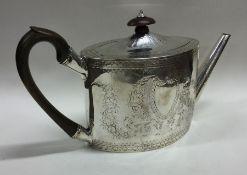 A good George III bright cut silver teapot attract