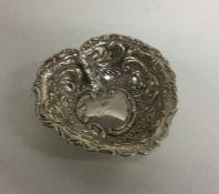 A small silver heart shaped pin dish. Birmingham.