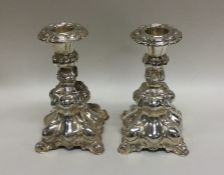 A pair of stylish Continental silver candlesticks