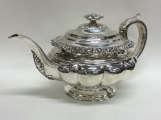 A good Georgian silver teapot of shaped form embos