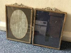 A good pair or rectangular silver picture frames.