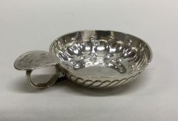 A 19th Century French silver wine taser with scrol