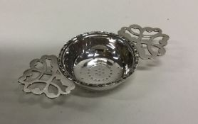 A good quality pierced silver tea strainer. London