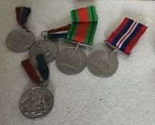 A box containing various medals. Est. £20 - £30.