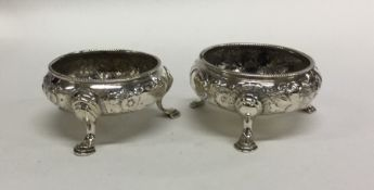 A pair of Victorian chased silver salts with flora