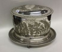 An attractive oval engraved biscuit barrel on ball