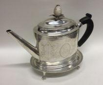 HESTER BATEMAN: A rare Georgian silver teapot on m