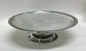 A Queen Anne silver tazza on spreading base. Londo