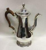 A Georgian silver baluster shaped coffee pot with