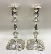 A good pair of Edwardian silver candlesticks of typical