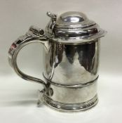 A rare Queen Anne silver lidded tankard with scrol