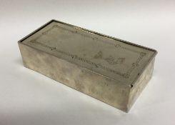 An unusual rectangular silver musical box with bri