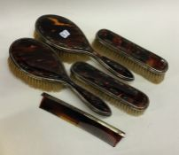 A tortoiseshell and silver inlaid dressing table s