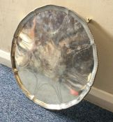 A large Georgian silver salver with crested centre