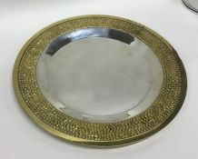 A heavy silver and silver gilt plate of typical fo