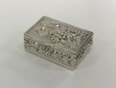 A novelty silver pill box decorated with vines and