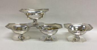 A good set of four Georgian silver salts of shaped