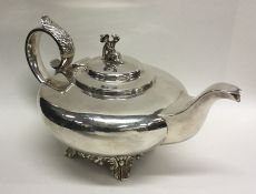A good William IV silver teapot of plain form on s