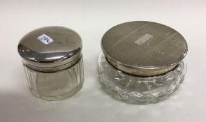 A heavy silver top powder jar together with one ot