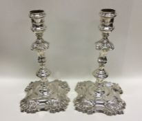 A good pair of Georgian cast silver candlesticks o