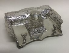 A good quality Edwardian silver inkstand profusely