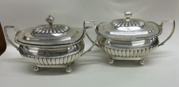 A good pair of Georgian silver tureens with fluted