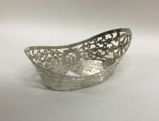 A heavy Continental silver pierced basket with bea
