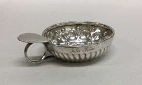 A French silver wine taster of plain form to flute