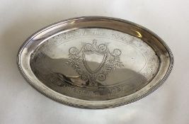 A large oval Georgian silver teapot stand with cen