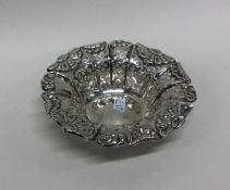 An Edwardian silver sweet dish with shaped edge. S