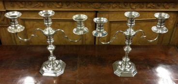 A good pair of silver Georgian style candleabra. B
