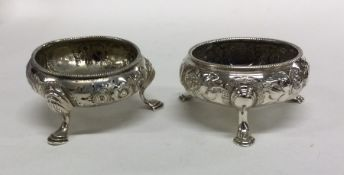 A good pair of Georgian silver salts chased with f