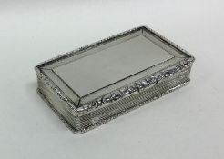 A heavy engine turned silver snuff box with reeded
