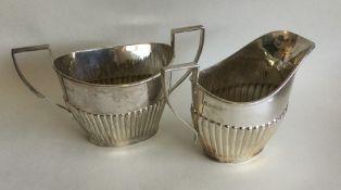 An Edwardian silver half fluted cream jug together