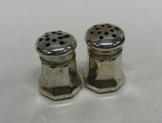 CARTIER: A pair of hexagonal silver peppers. Appro