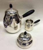 GEORG JENSEN: A rare silver three piece tea servic