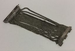 A heavy Continental silver bracelet with mesh stra