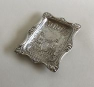 A novelty rare silver dish embossed with 'Mr Punch
