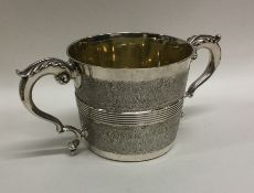 A heavy Georgian silver two handled loving cup wit