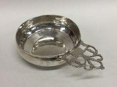 A rare 18th Century silver bleeding bowl with pier