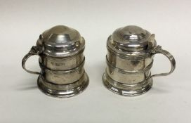 An attractive pair of Edwardian silver dome top mu