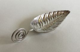 A good cast silver caddy spoon in the form of a le