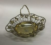 A fine quality silver gilt swing handled basket de