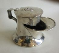 An Edwardian silver shaving stand on spreading bas