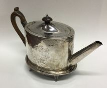 A good oval Georgian silver teapot on matched stan