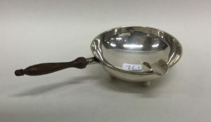 CARTIER: A small oval silver ashtray with turned w