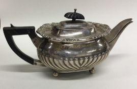 An Edwardian silver bachelor's teapot on ball feet