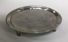 A heavy Georgian silver teapot stand with bright c