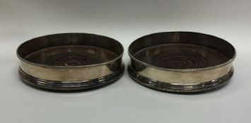 A good pair of Georgian silver wine coasters with